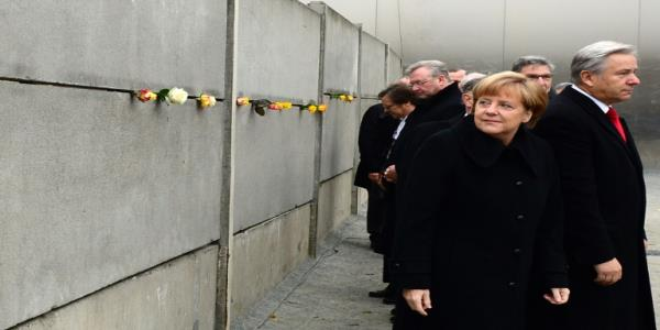 Sauna and oysters: Merkel recalls Berlin Wall fall