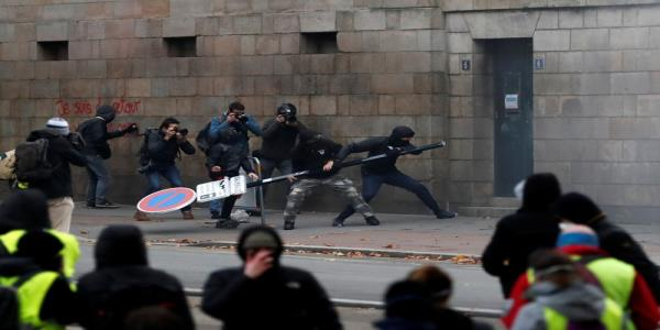 French interior minister blames protest violence on thugs